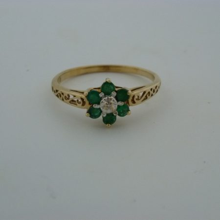 1773 emerald and diamond cluster ring